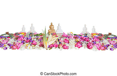 Ceremonial flowers and buddha figurines