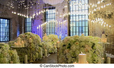 Ceremonial hall richly decorated with flowers and candles