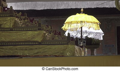 Ceremonial umbrellas in the temple, Bali, Indonesia -...