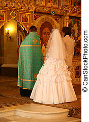 Ceremony in Church - The priest, groom and the bride on...