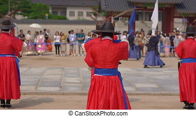 Ceremony of changing of the Royal Guard at Korean palace. Slow motion shot.