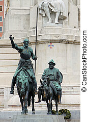 Cervantes monument placed on Plaza de Espana in Madrid, Spain. In front of monument are sculptures of Don Quijote and Sancho Panza