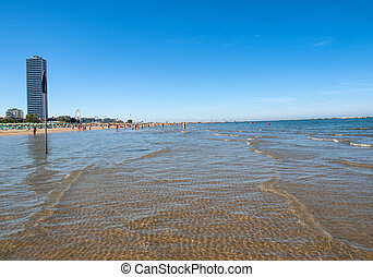 People are resting on a sunny day at the beach in Cesenatico...