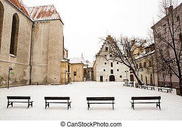 Small houses under snow in old city of Ceske Budejovice