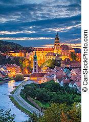 Aerial cityscape image of Cesky Krumlov, Czech Republic during summer sunset.