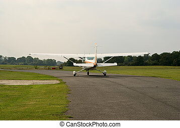 Cessna-172 on the taxiway - White Cessna-172 plane taxiing...