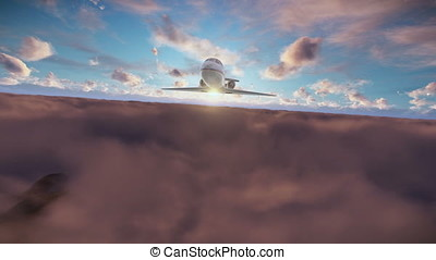 Cessna flying above clouds at sunset