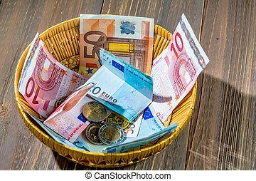 cesta, con, dinero, de, donaciones