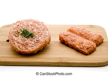Cevapcici and minced meat raw with parsley