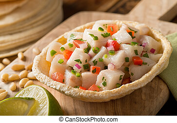Ceviche - A freshly made white fish ceviche with tomato, red...