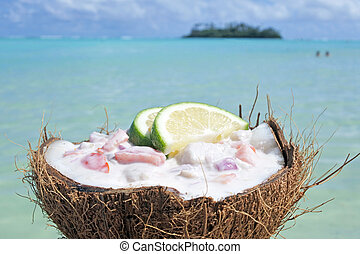 Ceviche Dish served in a coconut shell against islet in Muri...