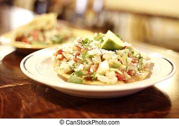 Ceviche on a tostada.