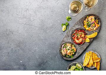 CEVICHE. Three colorful shrimps ceviche with mango, avocado...