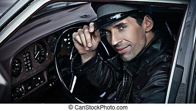 chófer, sentado, en el coche