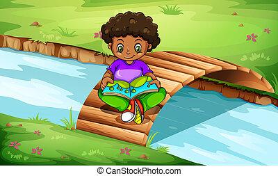 chłopieć czytanie, most