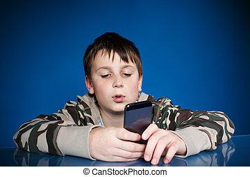 chłopiec, teenage, telefon, ręka