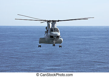 SAN DIEGO, CA - FEB 11: A CH-46E Marine Corps helicopter departs for a training mission prior to deployment at the Marine Corps Air Base in San Diego, CA on Feb 11, 2010.