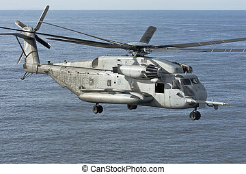 San Diego, CA - FEB 28: A US Marine Corps CH-53E Sea Stallion Helicopter departs the USS Peleliu as they begin workup manuevers for their upcoming deployment to the Persion Gulf near San Diego, CA on Feb 28, 2010.