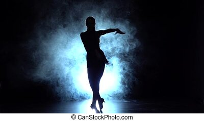 Cha-cha-cha dance in the studio, silhouette. Slow motion