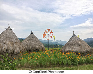 Chaff thatch orange wind mill and yellow flower