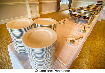 Chafing Dish and glass plates  at buffet