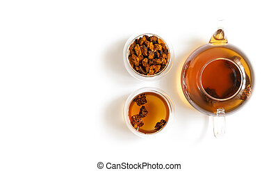 Chaga tea and chaga mushroom pieces in glass bowls and teapot isolated on a white background. Copy space, top view, flat lay.