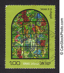 ISRAEL - CIRCA 1973: a stamp printed by Israel shows the Chagall Windows ( Chagall's stained glass windows ) in the synagogue, Hadassah Hospital , Jerusalem in honor of 12 Tribes of Israel, Asher, series, circa 1973