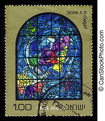 ISRAEL - CIRCA 1973: a stamp printed by Israel shows the Chagall Windows ( Chagall's stained glass windows ) in the synagogue, Hadassah Hospital , Jerusalem in honor of 12 Tribes of Israel . Benjamin, series, circa 1973