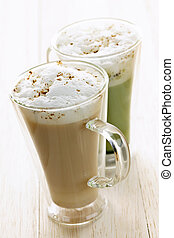Chai and matcha latte drinks - Two specialty tea latte...