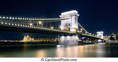 Chain brdige and Hungarian parliament building at night in Budapest
