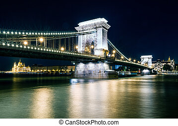 Chain bridge and Hungarian parliament building at night in Budapest