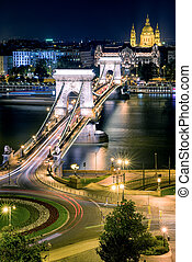Chain bridge and Stephen basilica at night in Budapest