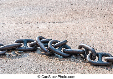 Chain for anchor from metal heavy iron on a gray background with a shadow. Side view.