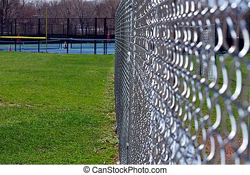 Chain link fence - A chain link fence in a park
