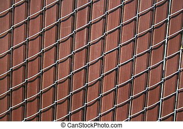 Chain Link Fence - Close up of a chain link fence showing...