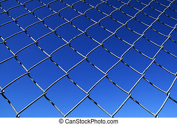 chain link fence mesh with blue sky background
