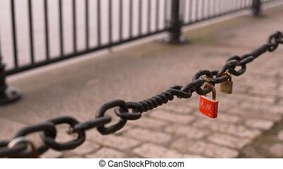 Closeup shot of chain with singular lock on it