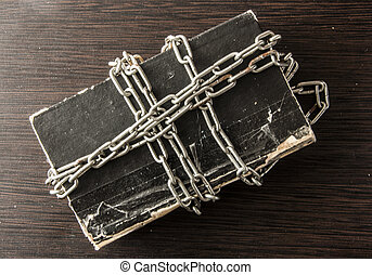 Chain wrapped around a book