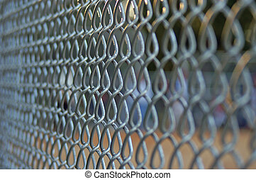 Chainlink Fence - Side view of a chainlink fence at a...