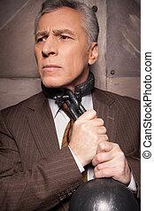 Chains on his neck. Grey hair senior man in formalwear...