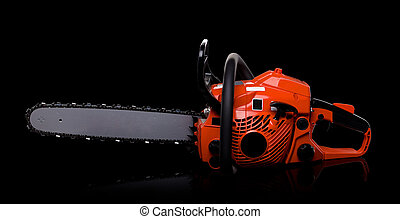 New red chainsaw isolated on black.