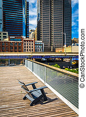 Chair and view of buildings in the Financial District from Pier