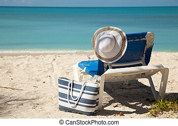 chair beach bag and hat