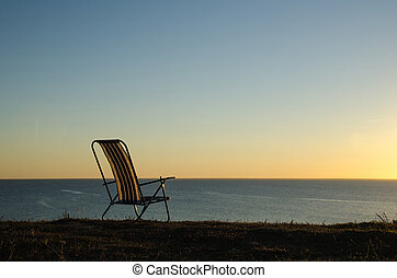 Chair by the coast