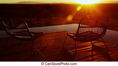 Chair in the porch at farmhouse during sunrise 4k