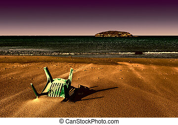 Chair in the Sand of Beach