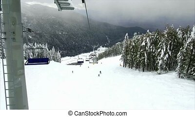 Chair lift in the mountains - Bulgaria.Bansko.12 March 2017....