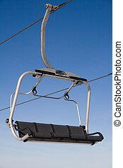 Chair lift in winter resort