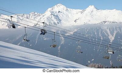 Chair lift - Ski lift on mountains background. Bormio, Italy...
