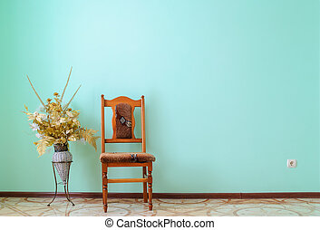 chair minimalism - classic chair on green wall with flowers ...